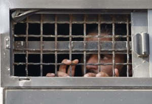 Palestinian prisoner looks out bus window before his release from Ofer prison outside Ramallah